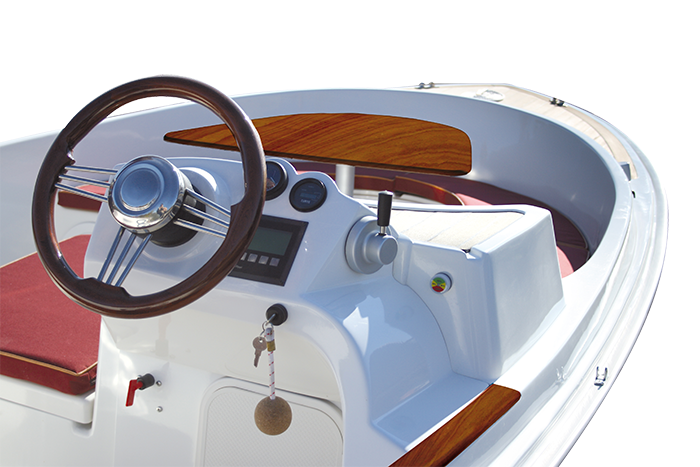 Scoop with cushions, table and mahogany steering wheel